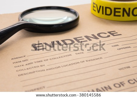 magnifying glass and evidence bag for detective and crime scene investigation - stock photo