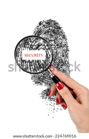 magnifying glass and fingerprint - stock photo
