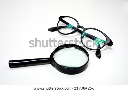 Magnifying Glass and Glasses isolated - stock photo