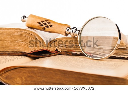 magnifying glass and old books - stock photo