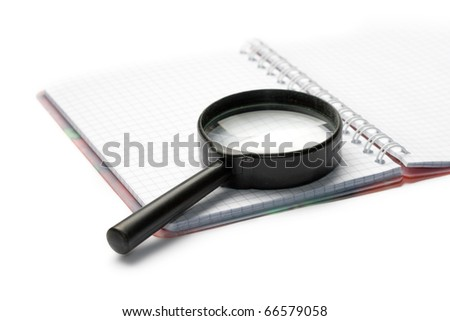 Magnifying glass and pad isolated on white - stock photo