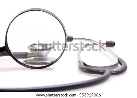 Magnifying glass and stethoscope isolated on white background.