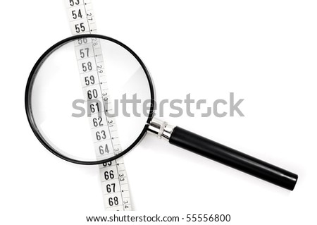 Magnifying glass and tape measure isolated on a white