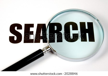 "Magnifying glass and text ""search"". Conceptual."