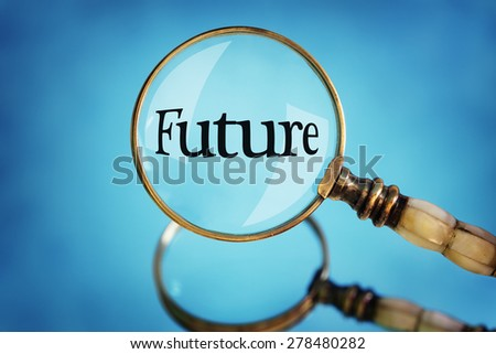 Magnifying glass focus on the word future concept for planning, vision and  looking forward - stock photo