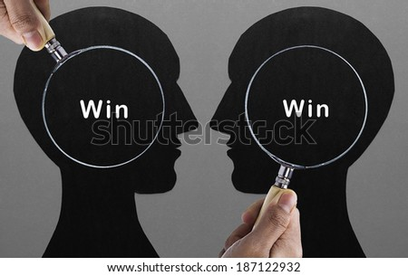 "Magnifying glass focus on  ""WIN-WIN situation""  - stock photo"