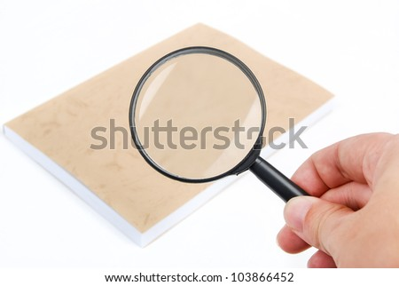 Magnifying glass focusing on book