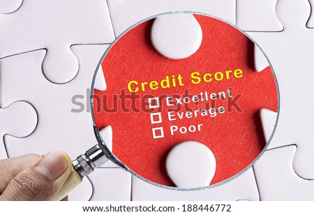 Magnifying glass focusing on Uncheck credit score evaluation form. - stock photo