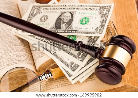 magnifying glass , gavel and old law books - stock photo