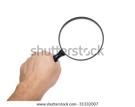 Magnifying Glass held in hand, shot in studio on a white background.