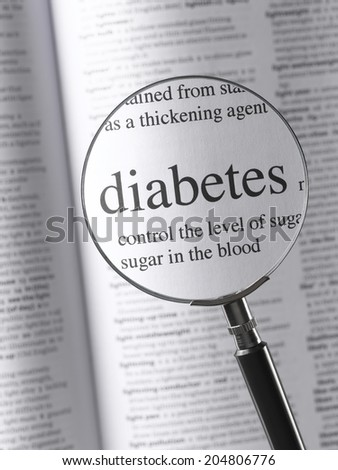 Magnifying Glass Highlighting diabetes - stock photo