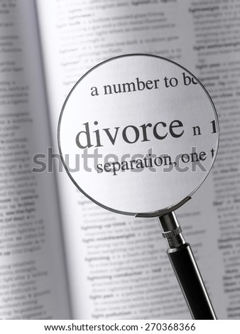 Magnifying Glass Highlighting Divorce - stock photo