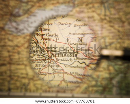 Magnifying Glass in front of a Pittsburgh map - stock photo