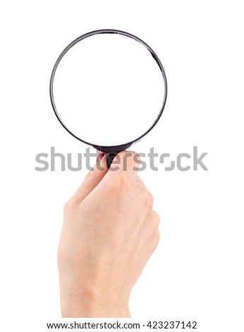 Magnifying glass in hand - stock photo