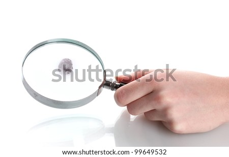 Magnifying glass in hand and fingerprint isolated on white - stock photo