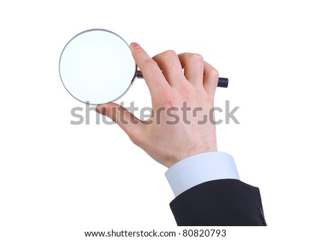 Magnifying glass in hand isolated on white background - stock photo