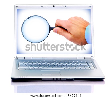 Magnifying glass in hand isolated on white background in laptop - stock photo