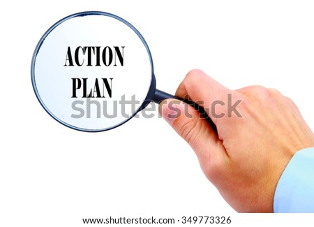 "Magnifying glass in hand isolated on white background searching ""Action Plan"""