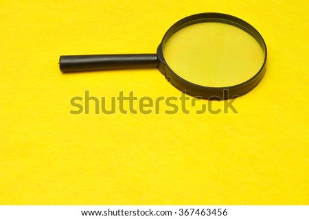 Magnifying glass isolated on a yellow background