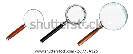Magnifying Glass isolated on White Background. Set of Three Classic Design with Plastic and Wooden Handle. - stock photo