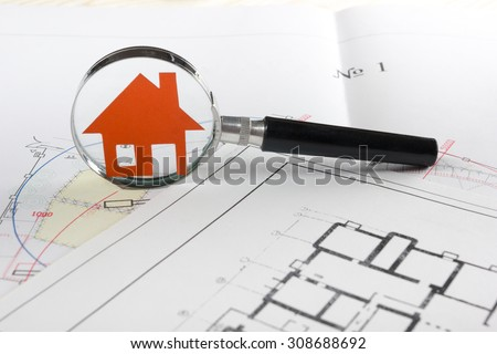Magnifying glass, model house, construction plan for house building.  Real Estate Concept.  - stock photo
