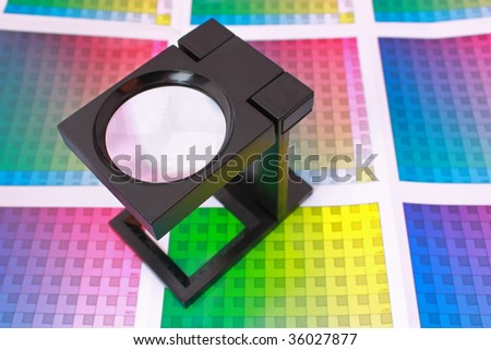 Magnifying glass on color swatch. Color Selection Pre-Press concept - stock photo
