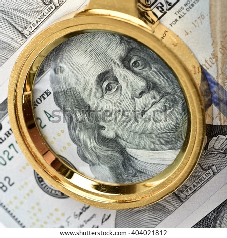 Magnifying Glass on the Franklin hundred dollars - stock photo