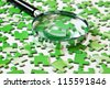 magnifying glass on the green puzzle - stock photo