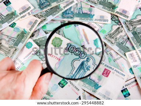 Magnifying Glass on the Russian Currency Background - stock photo