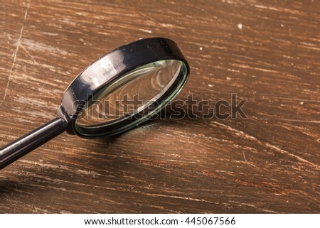 magnifying glass on the  wooden background