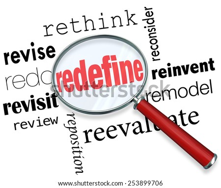 Magnifying glass on the word Redefine and related terms such as revise, redo, revisit, review, reposition, rethink, reconsider, reinvent, remodel and reevaluate - stock photo