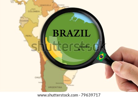 Magnifying glass over a map of Brazil - stock photo