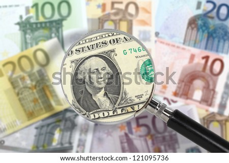 Magnifying glass over euro notes. US dollar in the foreground. EU economy under US custody. Financial crisis concept - stock photo