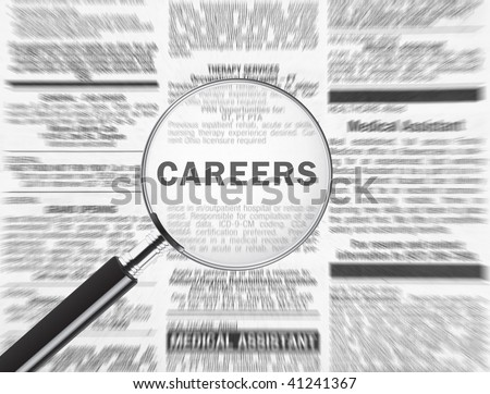 Magnifying glass over the word careers in the newspaper - stock photo