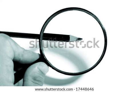 Magnifying Glass, pencils - stock photo