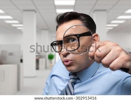 Magnifying Glass, Scrutiny, Analyzing. - stock photo