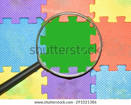 Magnifying glass searching missing puzzle word