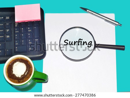 """Magnifying glass searching """"SURFING"""", Internet concept  - stock photo"""