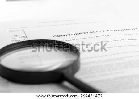 Magnifying glass. Signing documents. Partnership agreement. Search information. - stock photo