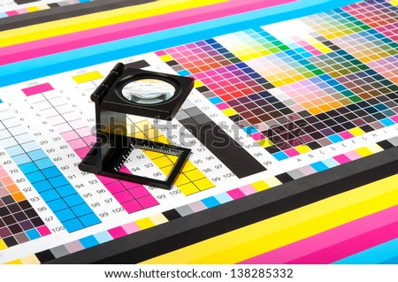 Magnifying glass standing on a leaf of the test print - stock photo