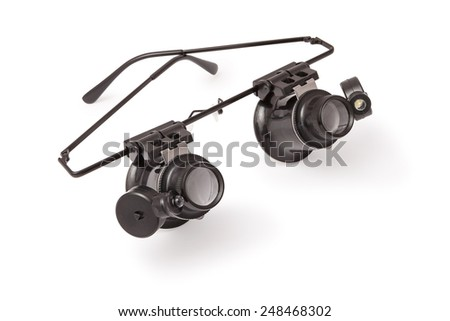 magnifying glass with illumination on a white background - stock photo