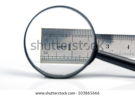 Magnifying glass with metal ruler