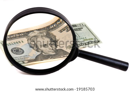 magnifying glass with money - stock photo