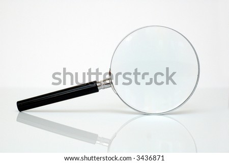 Magnifying glass with reflection - searching concept. - stock photo