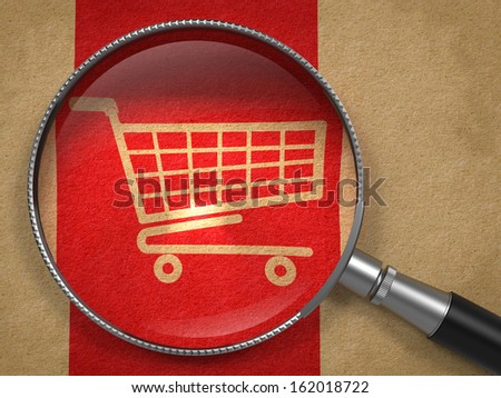 Magnifying Glass with Shopping Cart Icon on Old Paper with Red Vertical Line Background. Business Concept. - stock photo