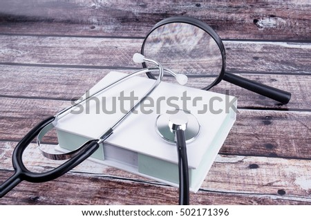 Magnifying glass with stethoscope