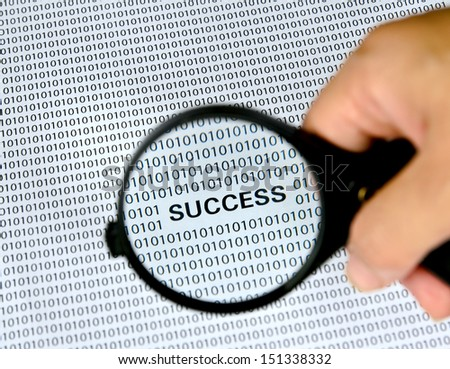 Magnifying glass with success word on background . - stock photo