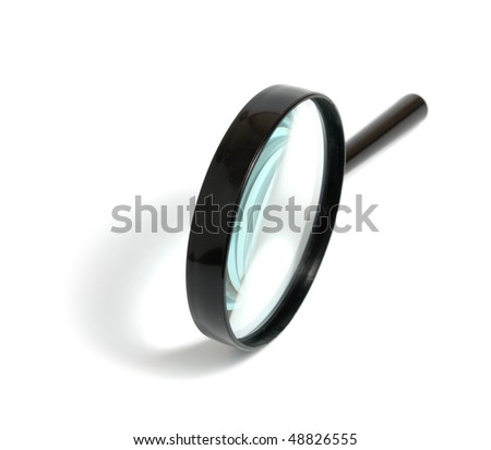 Magnifying glass with the black plastic handle on a white background it is isolated - stock photo