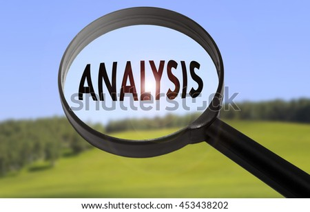 Magnifying glass with the word analysis on blurred nature background - stock photo