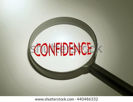 Magnifying glass with the word confidence. Searching confidence